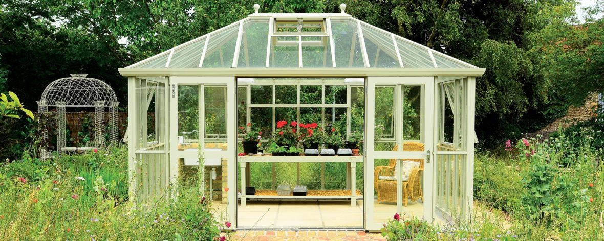 Front View of a White Hartley Botanic Westminster Greenhouse