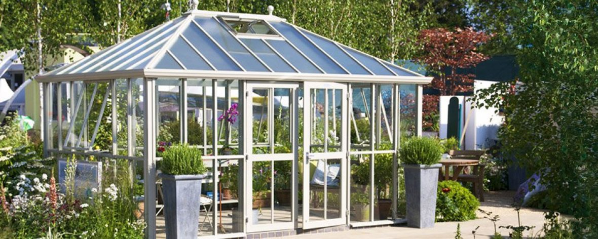 A white Hartley Botanic Westminster greenhouse